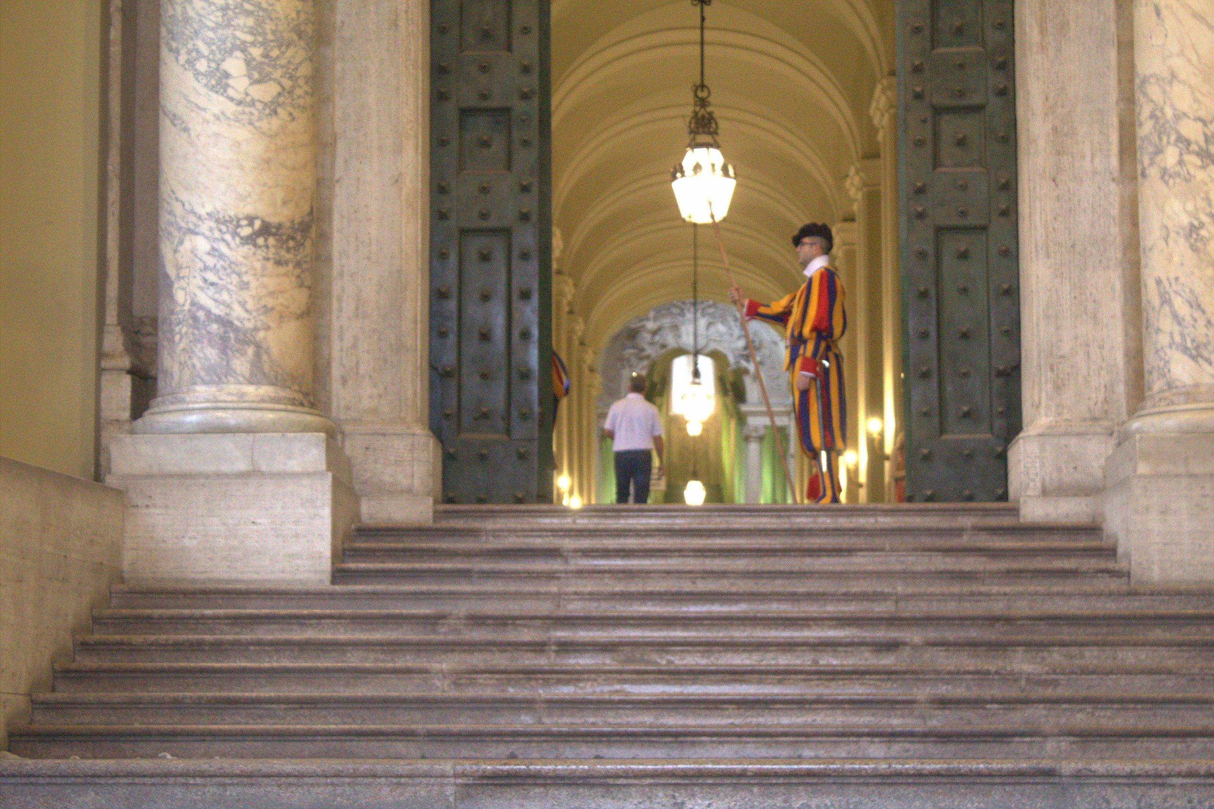 A member of the Swiss Guard stands watch outside of The Vatican in Rome.