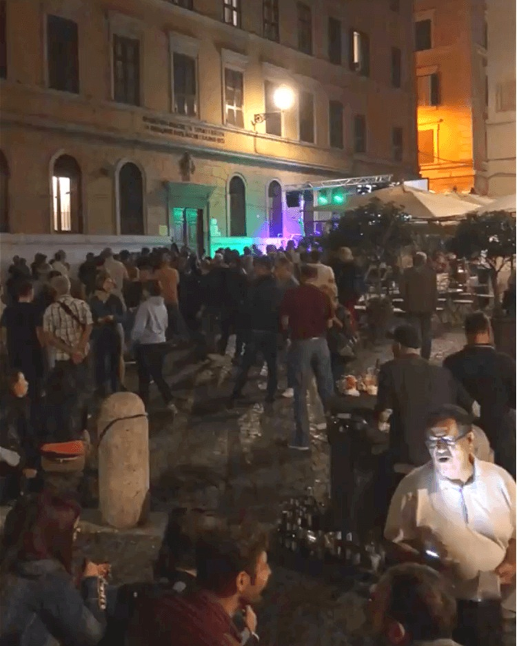 An outdoor concert happening in Piazza Monti during a Autumn event in Rome