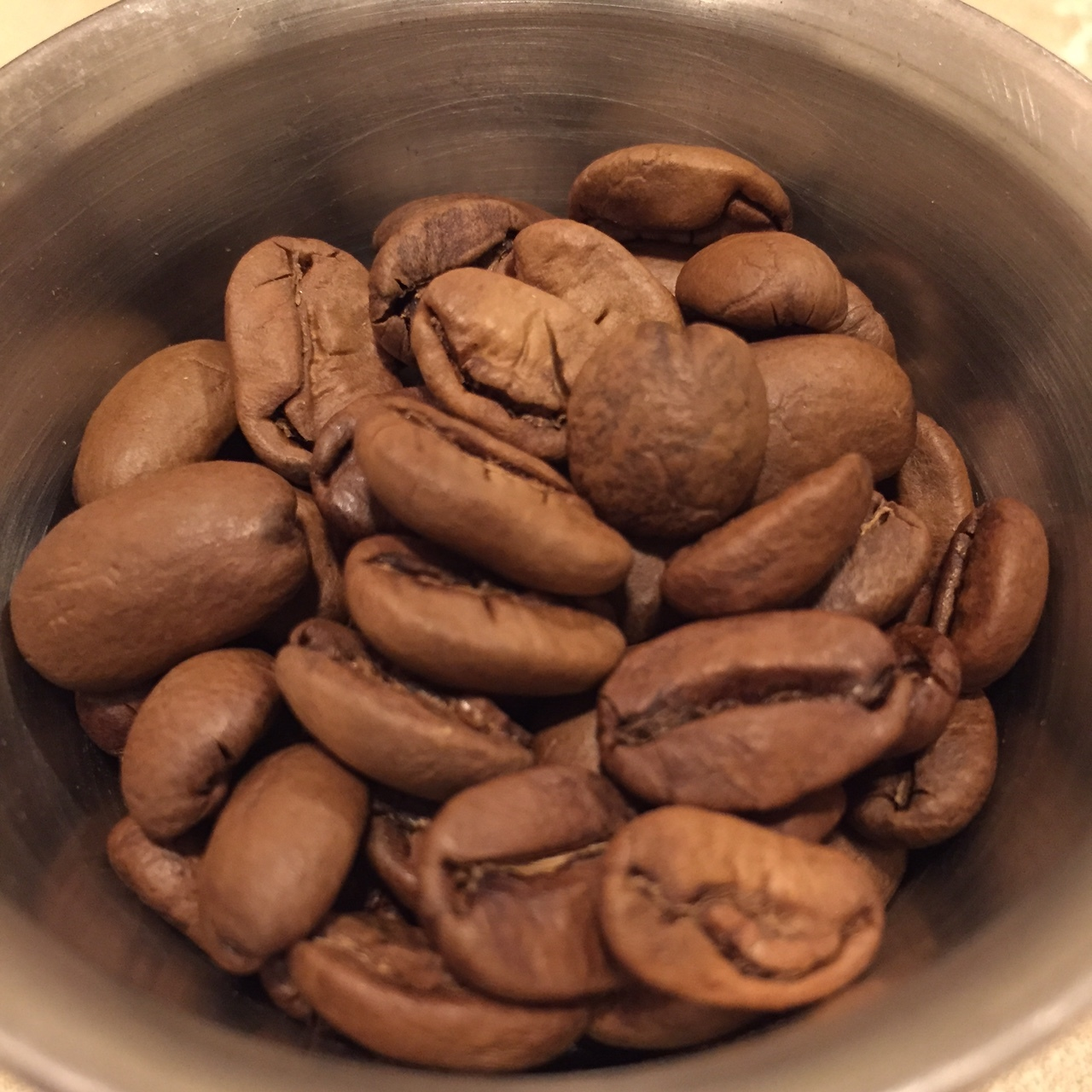 Very large light brown Pacamara varietal beans.