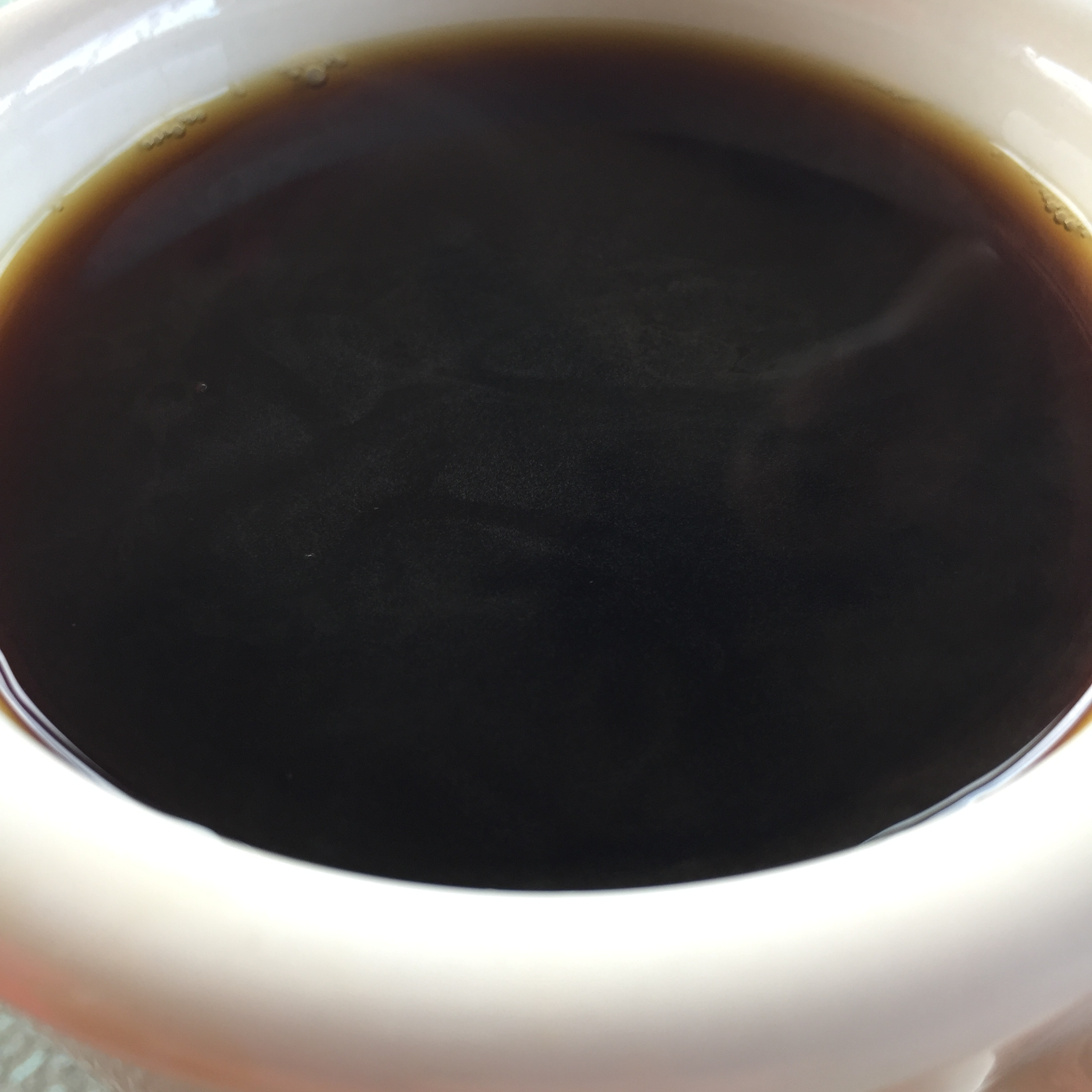Delicious visible oils on the surface and just a really pleasant, sweet, and balanced cup of coffee.