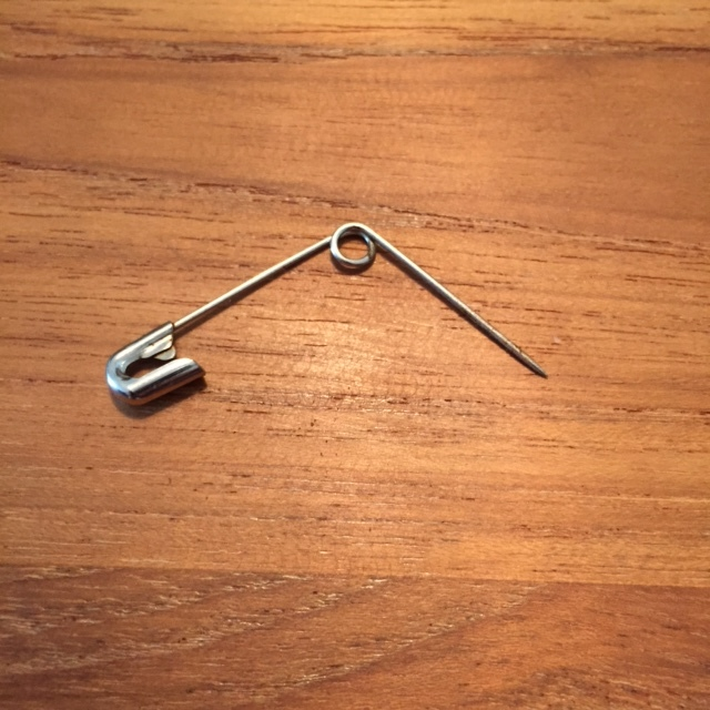 I just use a simple paper clip and hold by the tab end.