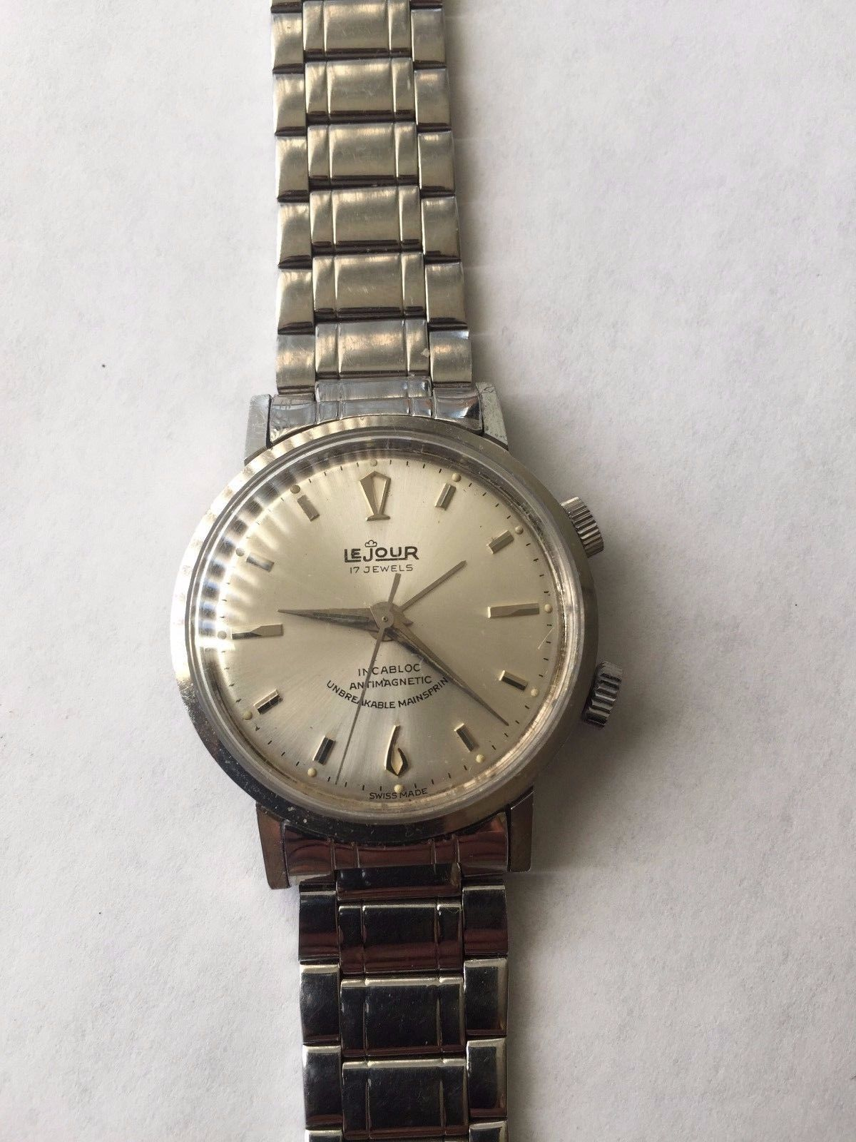 The dramatic Art Deco numeral and indices are sure to catch the light and make that silver sunburst dial sing.  Photo from eBay FS listing, click through for more info.
