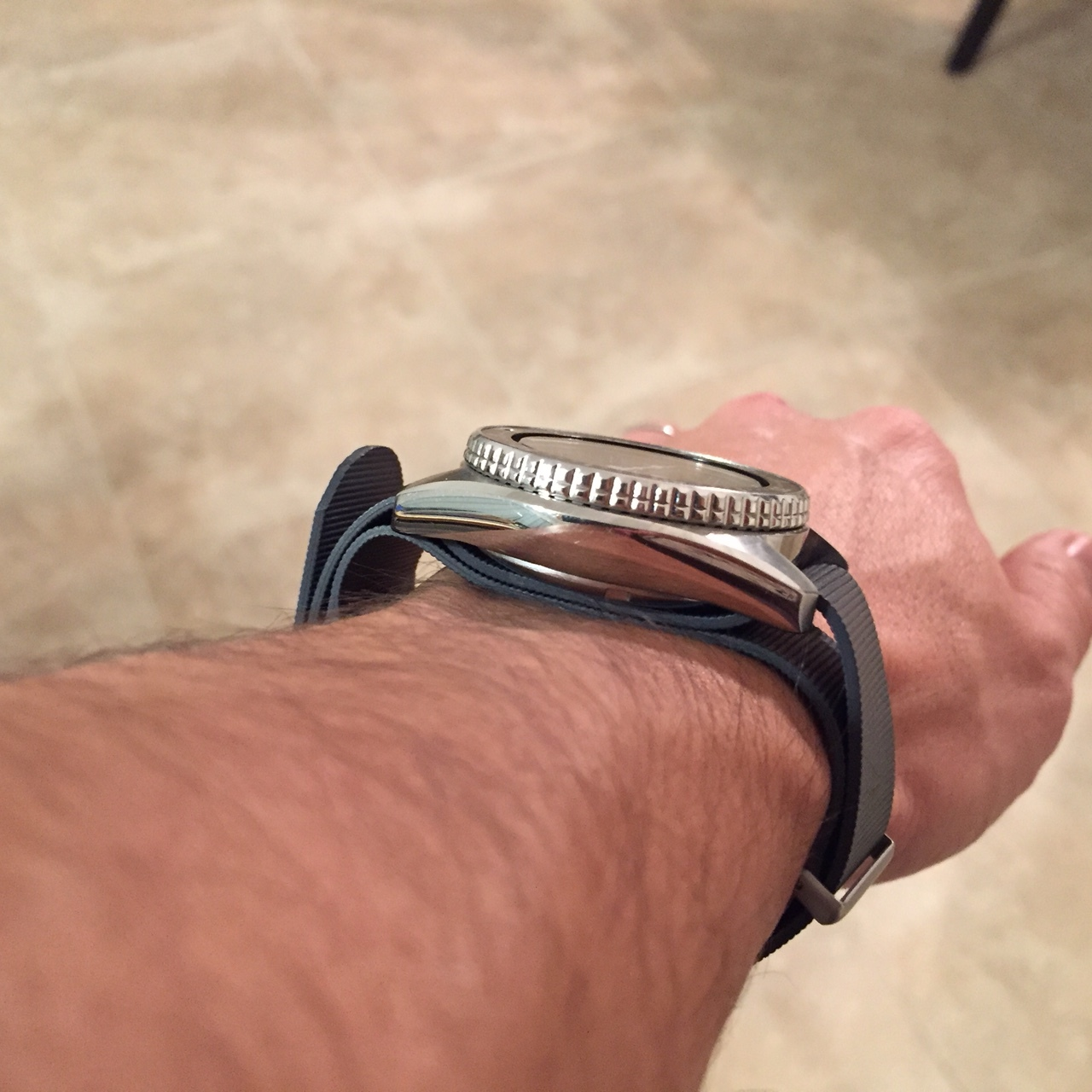 The rubber definitely sits a little thicker than a traditional nylon NATO making a thick watch sit even higher.