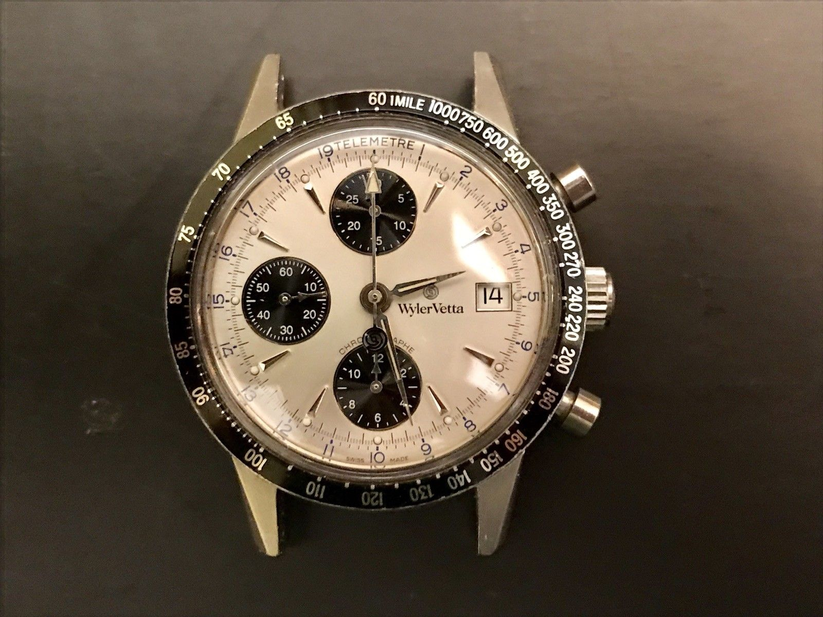 Three register chrono, good hands, panda dial, stainless steel case, 38mm, original and running! Photo courtesy of FS listing on eBay, click through to make an offer.
