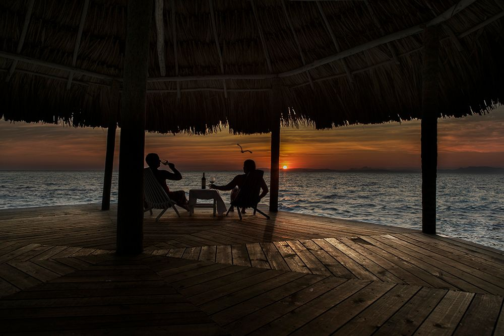 Copy of thatch caye wine at sunset on serenity point.jpeg