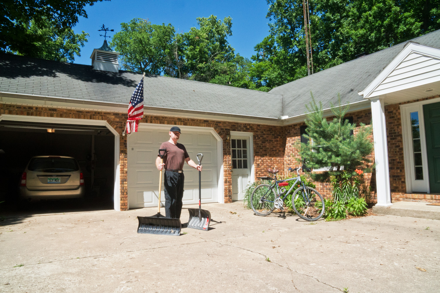 Rebel Joe, proudly showing off his snow shovels on a hot day in June. Way to go, Joe!