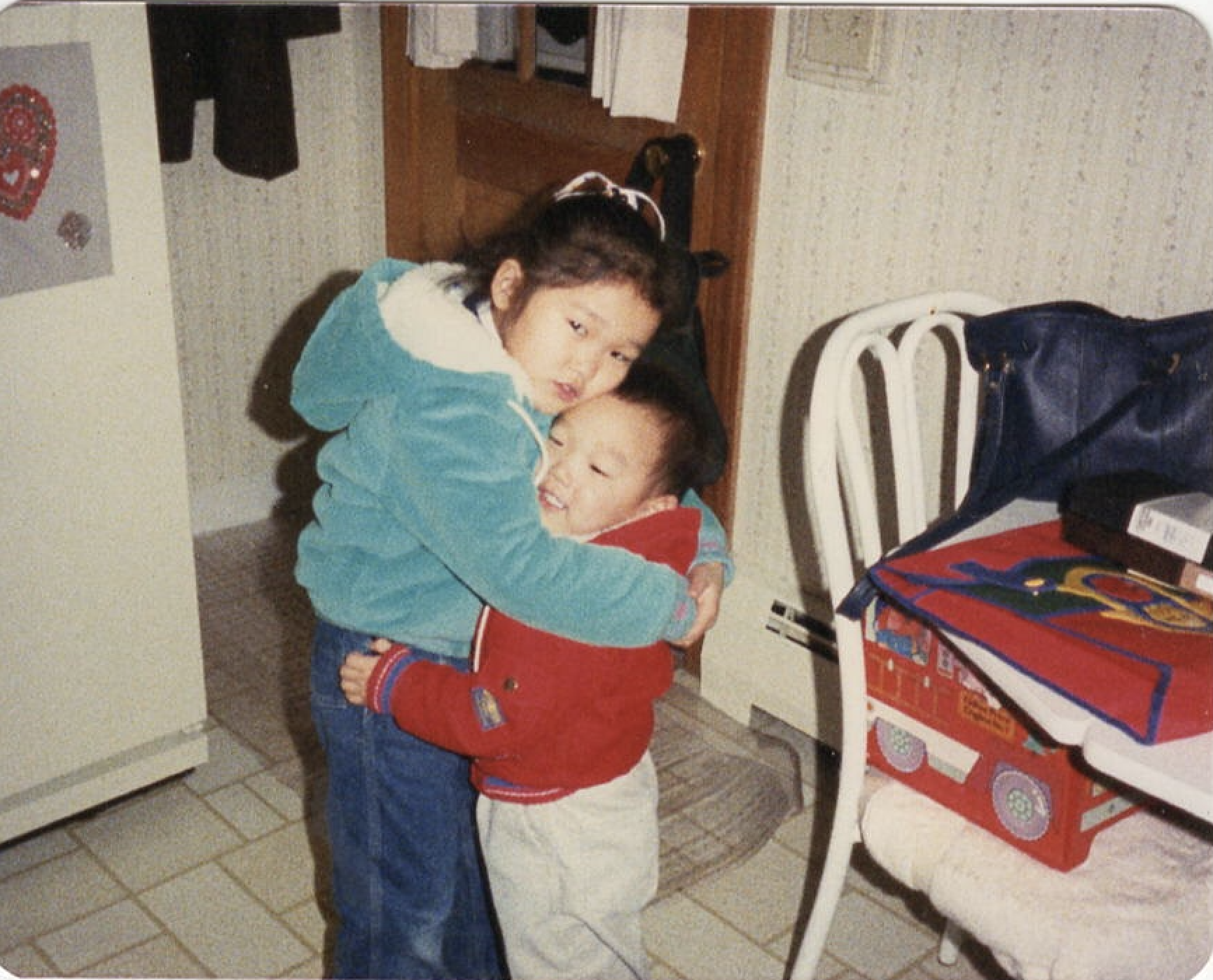 Forcing Chris to hug me.  He ran away in the next frame.  My little bro is now bigger than me.  Love him so much.