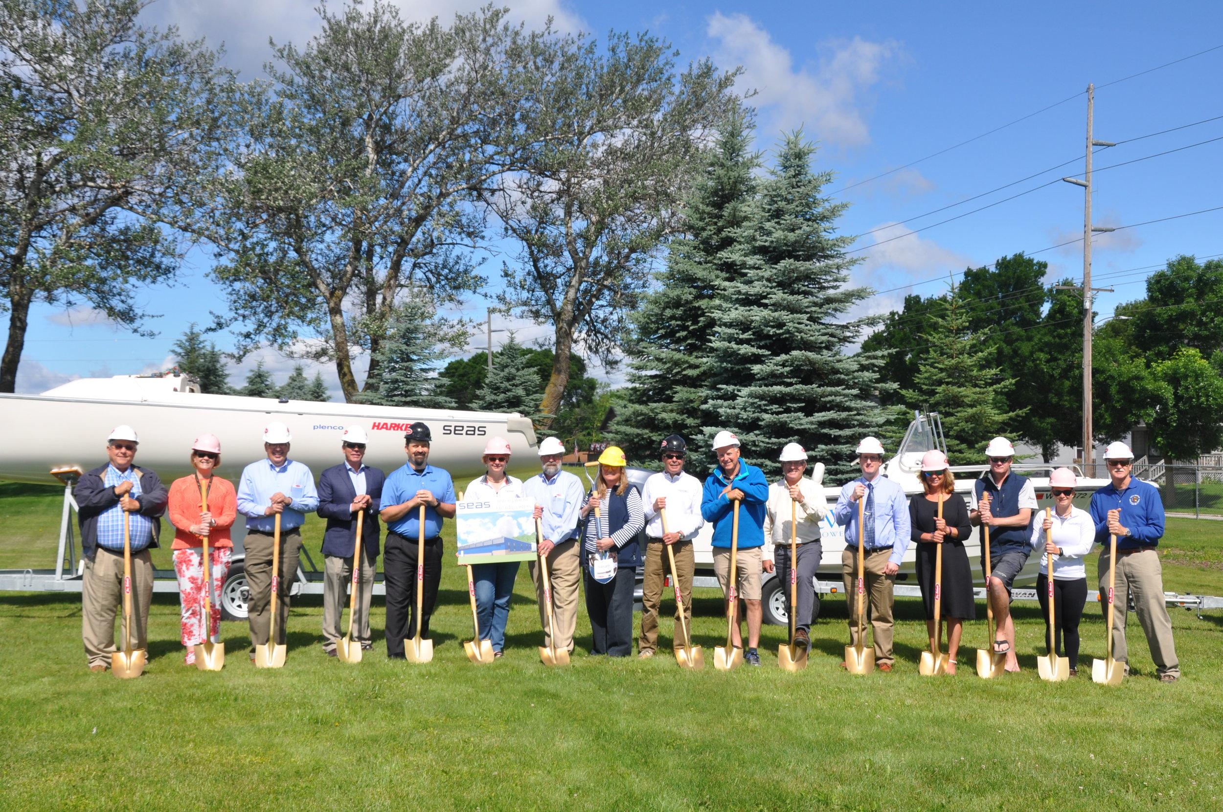 SEAS chairman, Leslie Kohler, staff, board members, The Vollrath Co., LLC representative, Jos. Schmitt Construction and LJM Architects break ground on 6/27/17.