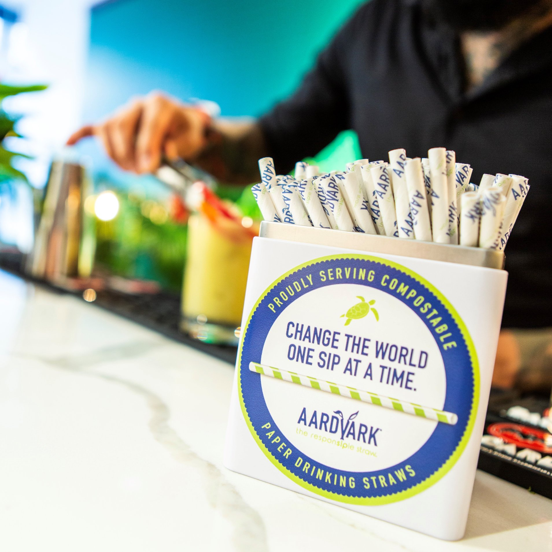"CHANGE THE WORLDONE SIP AT A TIME - We brought Aardvark's products to the forefront of the ecological movement that is sweeping the world..THE CONCEPTWith the banning of plastic straws around the world, Aardvark was poised to take over the market with their advanced, custom paper straw technology. I developed their branding, experience design and brought their message to the public. We hosted a series of ""Death of the Plastic Straw"" funerals at events such as Tales of The Cocktail in New Orleans. Here, we hired a 2nd Line jazz band to proudly celebrate the death of the plastic straw complete with sea turtle costumes and a glass casket where consumers could toss their old plastic straws in exchange for new Aardvark ones.THE RESULTSAardvark was the talk of Tales of The Cocktail! By taking over the streets of the French Quarter, we drew attention to the great ecological work the brand is doing. Since our program began in early 2019 the company has grown 5x in size. The demand is overwhelming. We also paired them up with restaurants, Bacardi and Angostura and brought them into the limelight as the go-to American straw."