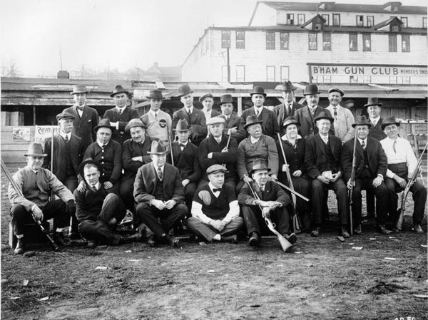 "Our ""precursor"" - The Birmingham Gun Club, c. 1914, at the old Alabama Fairgrounds, with special guest John Philip Sousa (seated at lady's right). In addition to conducting the USMC Band and writing hundreds of march tunes, Sousa was an early proponent of trap shooting in the U.S.A."