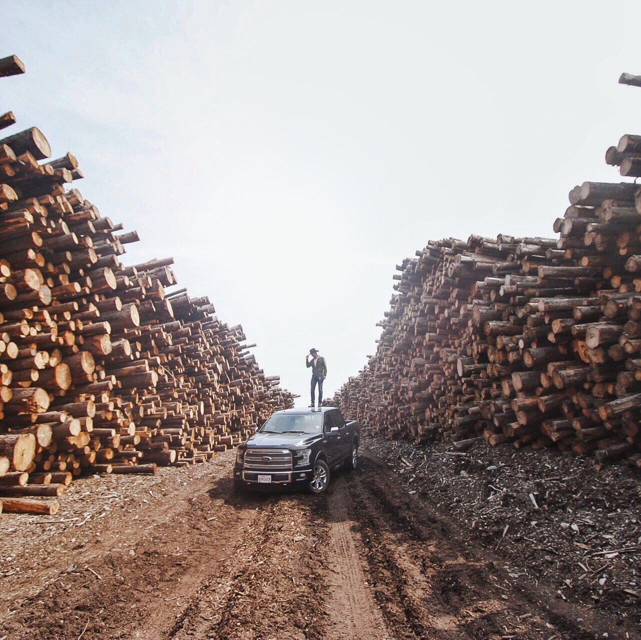 Paul standing on a Ford in a sawmill.