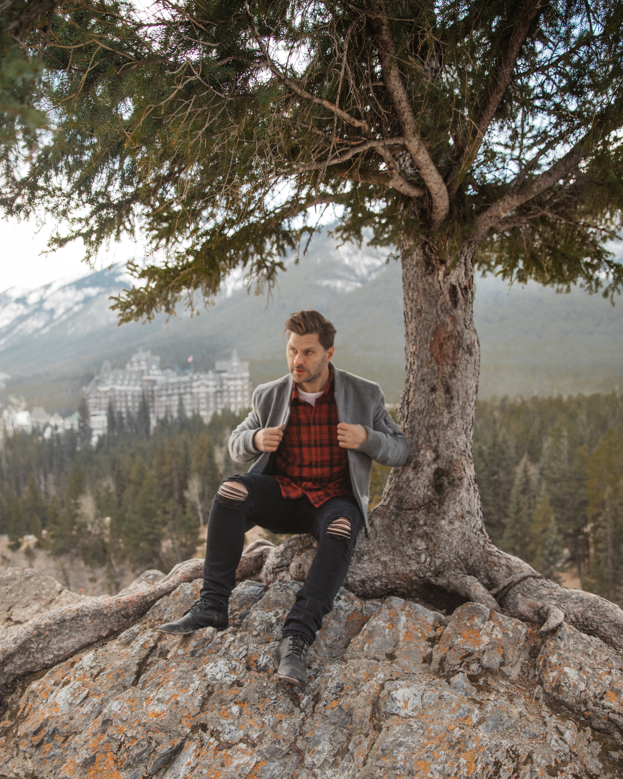 Paige Denim in front of The Banff Springs Hotel.