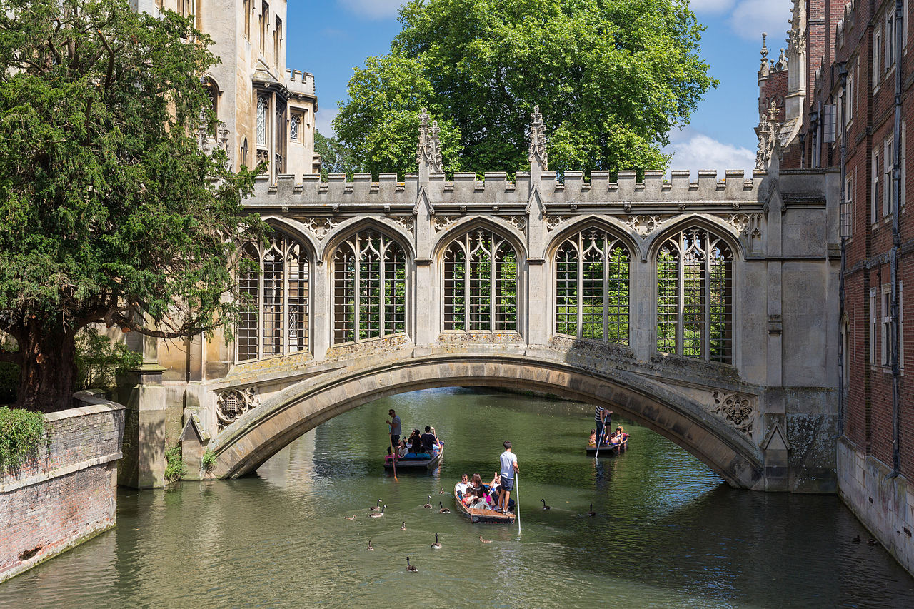 Punting under the Bridge of Sighs on the River Cam in Cambridge