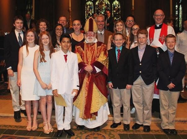 Our group of newly-confirmed and received in the Cathedral of St. John the Divine, with the Bishop of New York and our Rector, Fr. Nils Chittenden.