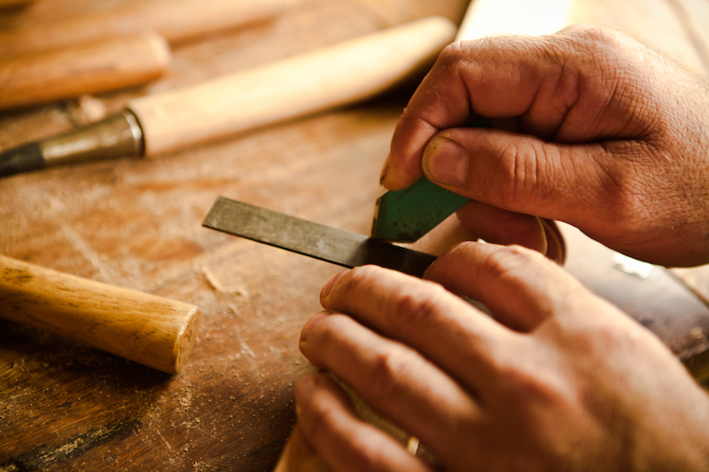 Using a square and marking knife to prepare for crosscut sawing by hand.