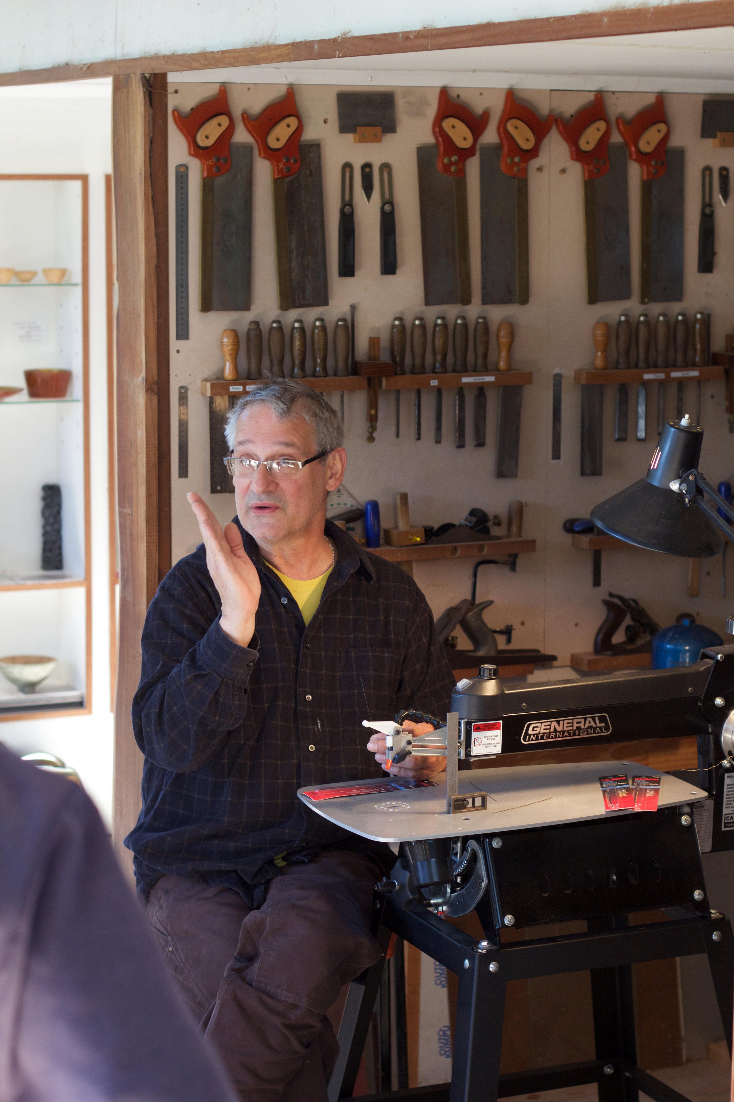 Brian Reid leading a woodworking class in the Cooroora Institute teaching studio