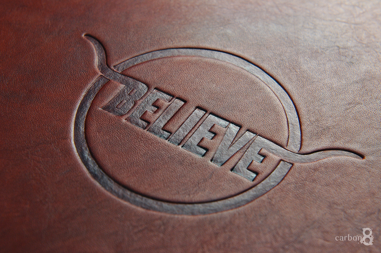 Debossed logo on leather