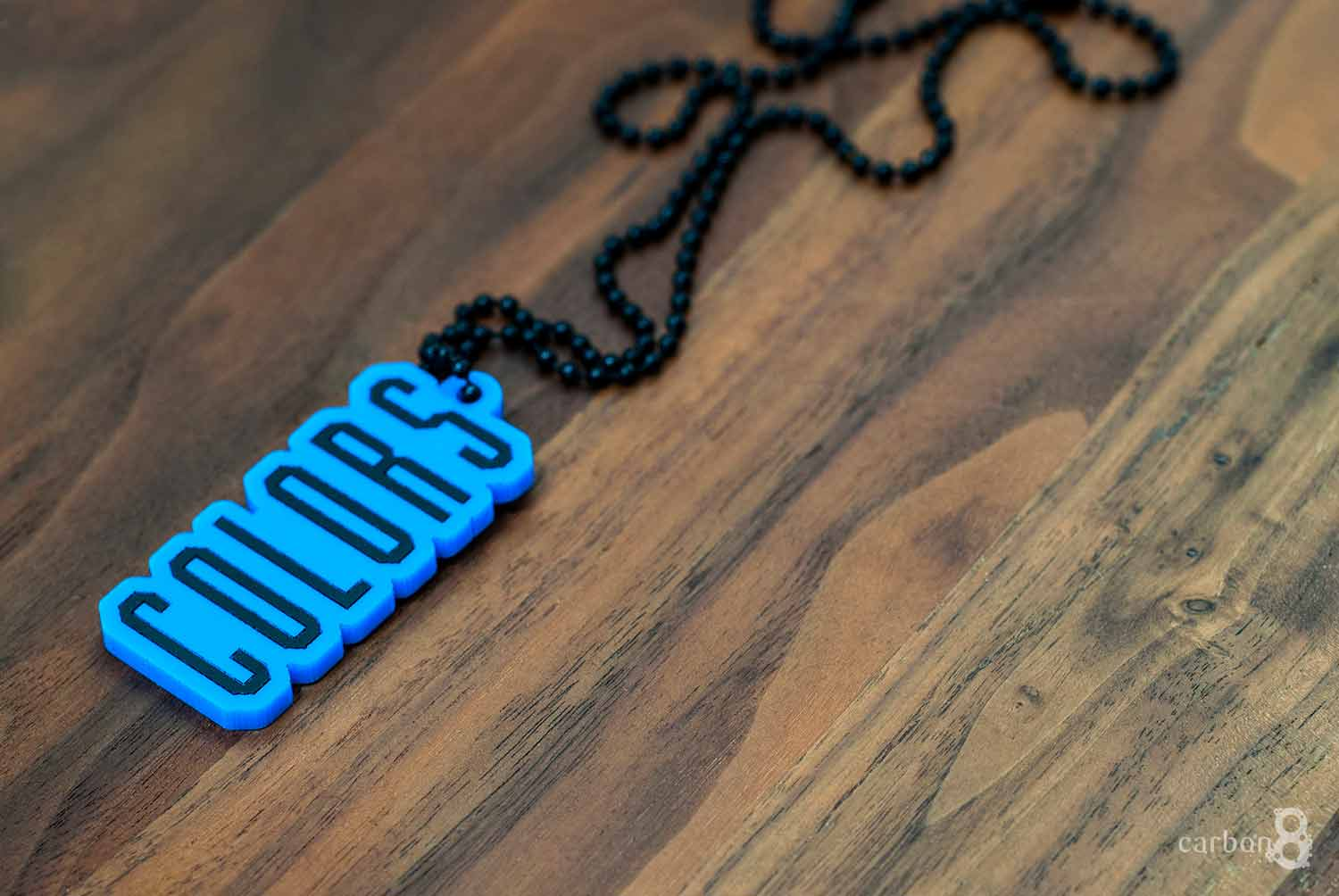 Laser cut acrylic pendent coloured