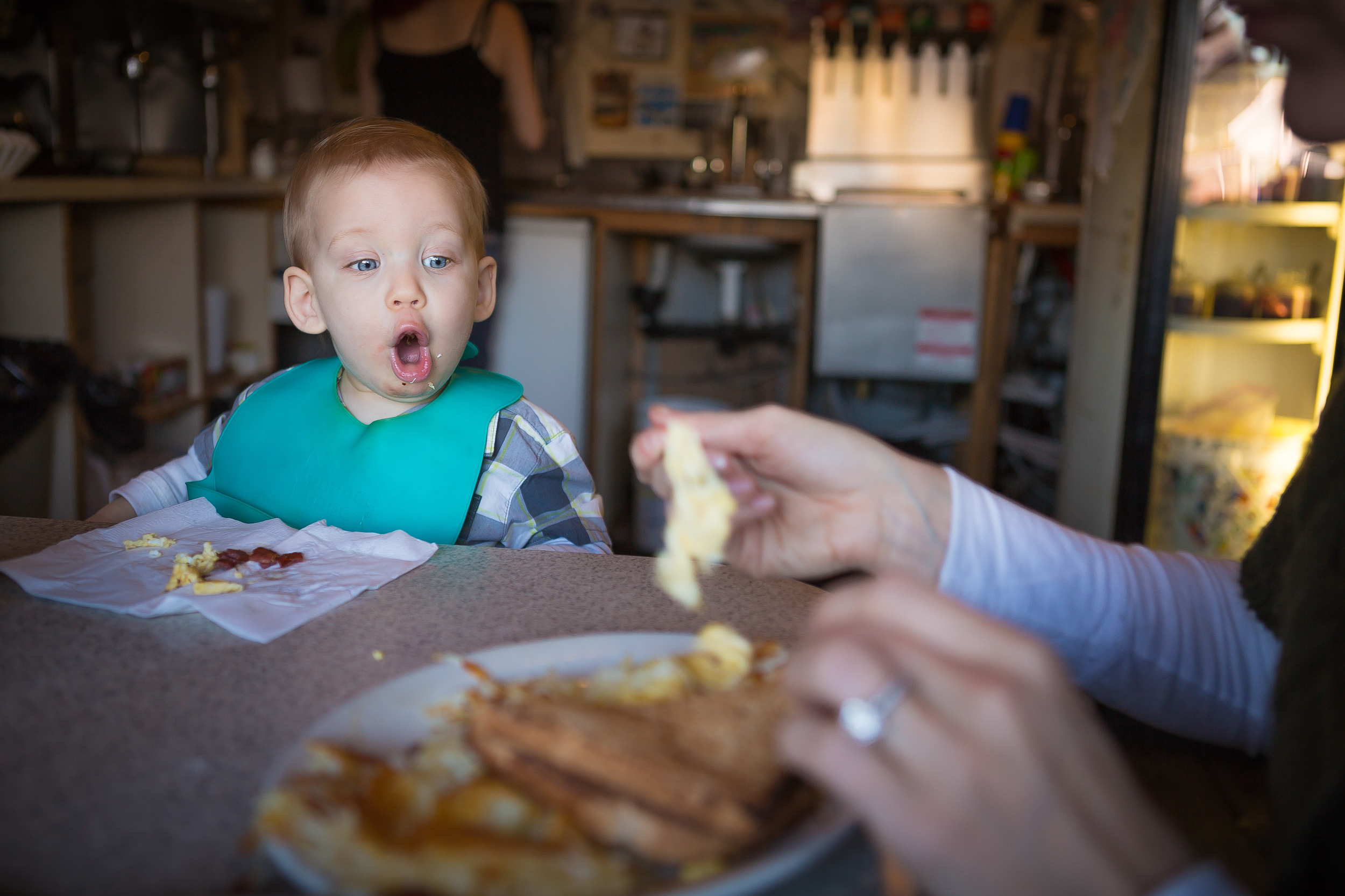 The AV was set at 2.8 for this picture of my son who wigged out when he saw the big plate of food they brought mom. If the AV had been high like a 22 then everything would be in focus and would draw attention away from the main focal point of the shock on my sons face.