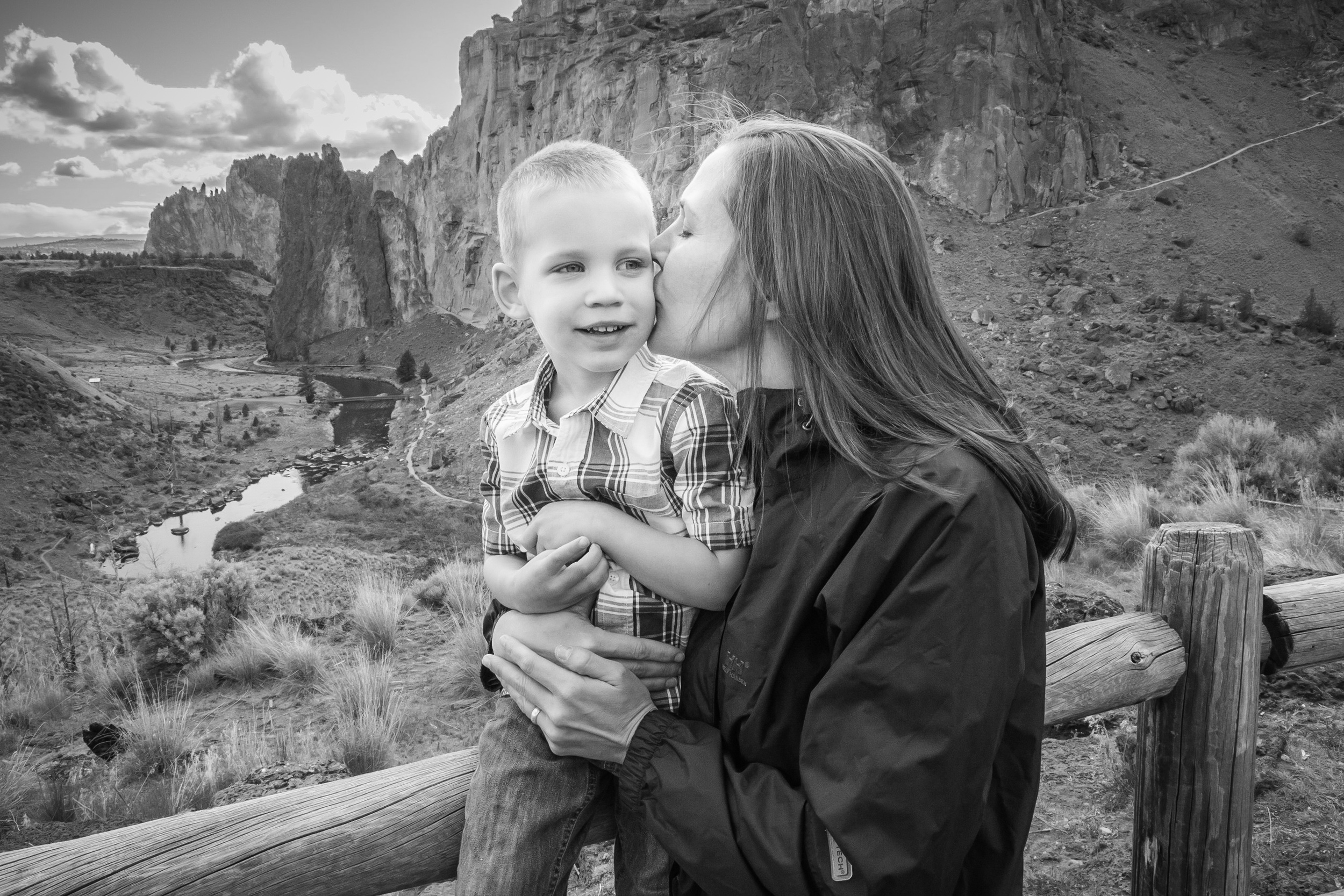 The AV was set at 22 for this photo to ensure I got good focus on both my wife and son as well as the Smith Rock park in the background. If the AV was low like a 2.8 or 4.0 then you would have lost all the beautiful detail in the unique rock formations behind them.