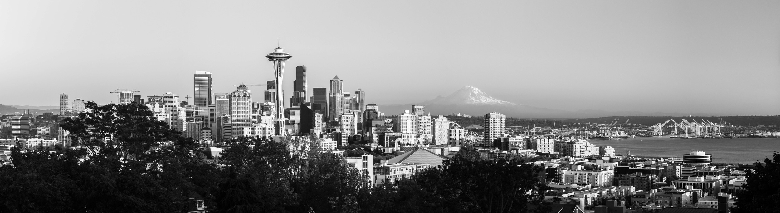 The AV was set to 11 to put the sharpest focus on the city but leaving enough focus on the foreground and background to enjoy Mt Rainier in the distance. If it was a low AV like 2.8 then you would not be able to make out that there was a mountain in the background.