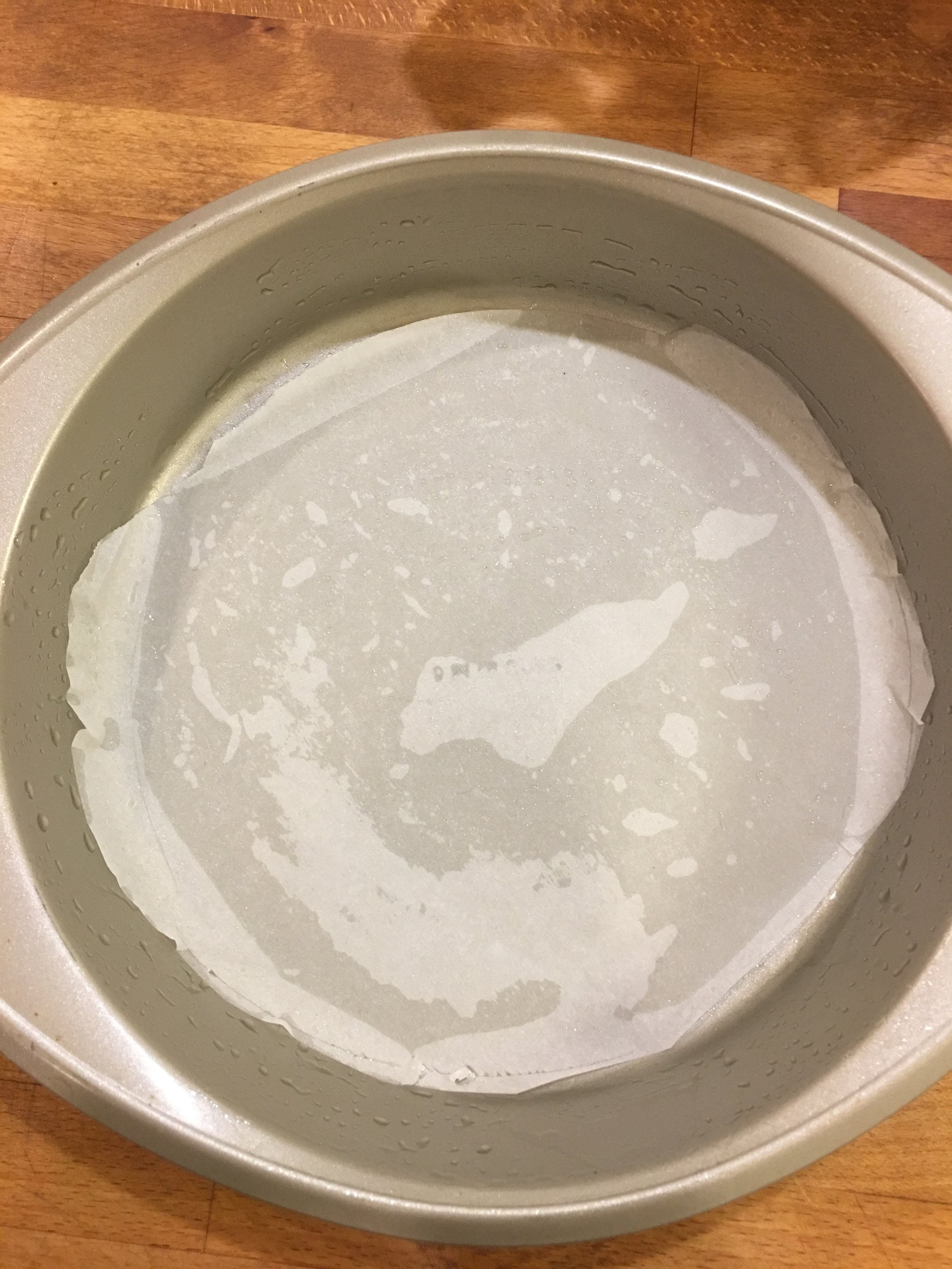 I was sloppy with my cutting. I didn't want to draw on the paper, but it was actually helpful to have the paper go past the bottom crease of the pan.