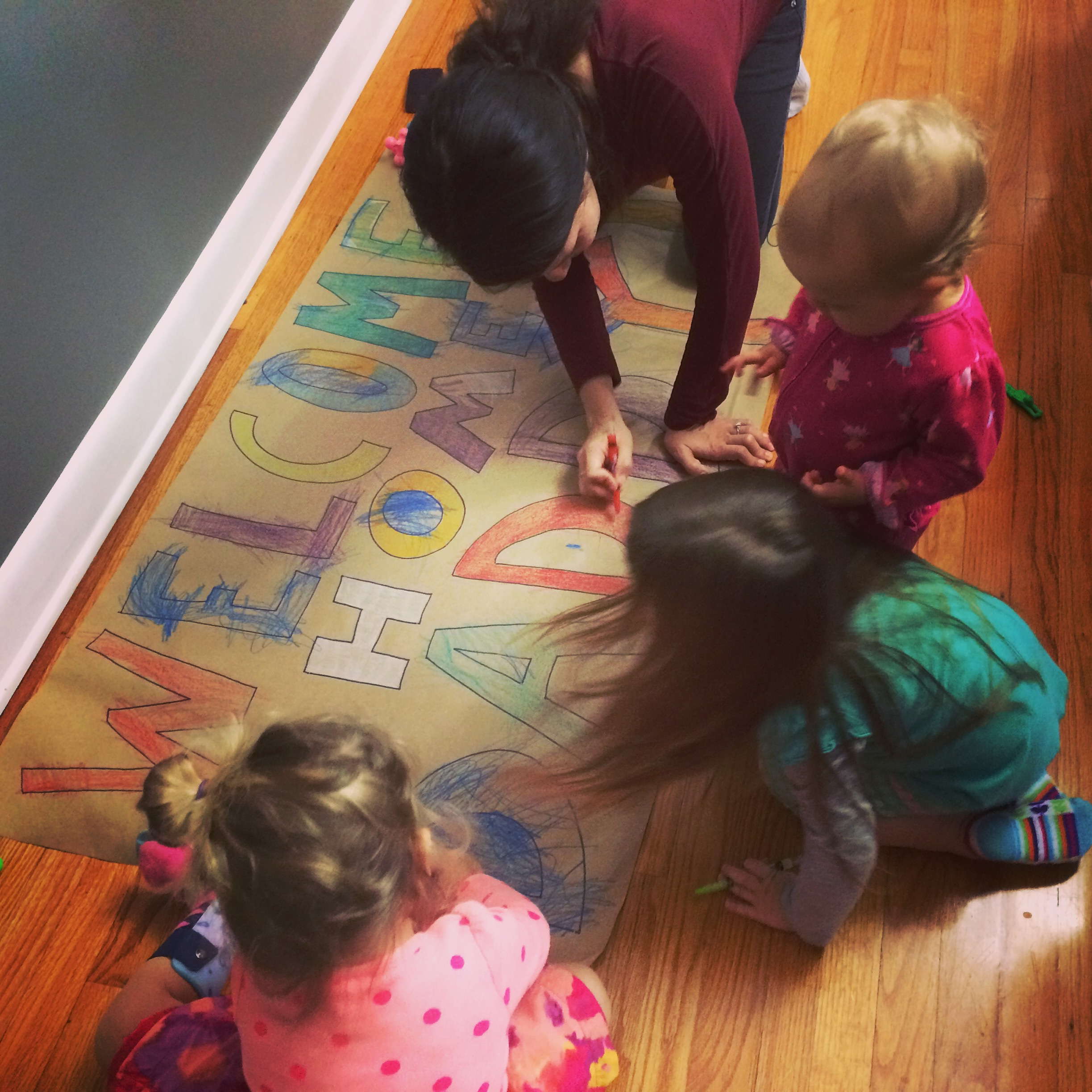 My girls with their Auntie preparing a sign for daddy, morning of his return.
