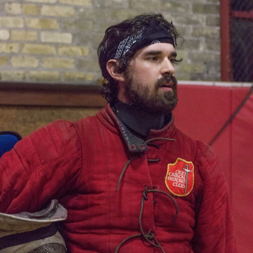 Adam Franti  Adam is a three-weapon Fechter in the Meyer Freifechter Guild and a Free-Scholar of the Historical Fencing Association. He started modern olympic fencing in 2005, and has been active in HEMA tournaments since 2015, earning multiple medals in longsword and rapier. Having earned a master's degree in history in 2018, he uses his academic skills to study the martial culture of Early Modern Europe, with a particular focus on the Freifechter tradition of Germany, and Salvatore Fabris' rapier system.  In 2017, Adam found the Lansing Longsword Guild, and has been an event organizer and instructor for the clubs in Michigan, and was one of the founders of the Midwest Historical Fencing League. He hopes to promote deep source study and healthy body mechanics to create skillful, crafty fencers that are, above all, fun to fence.  Classes: Secrets on Display - Public Fencing in the 16th Century, Fabris Body Mechanics