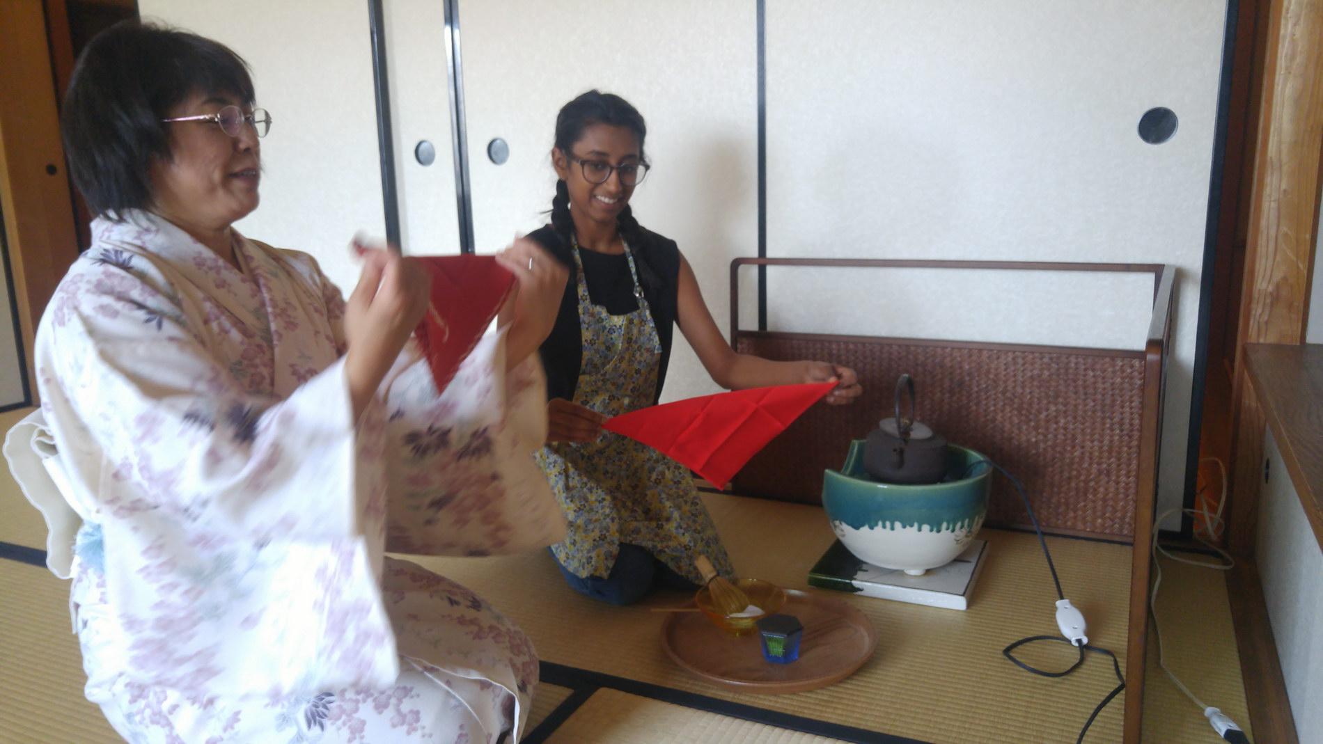 Tea ceremony: teacher showing how to perform tea serving etiquette