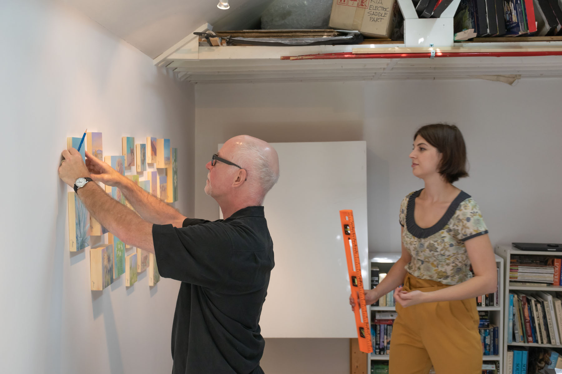Hanging Jominca's paintings