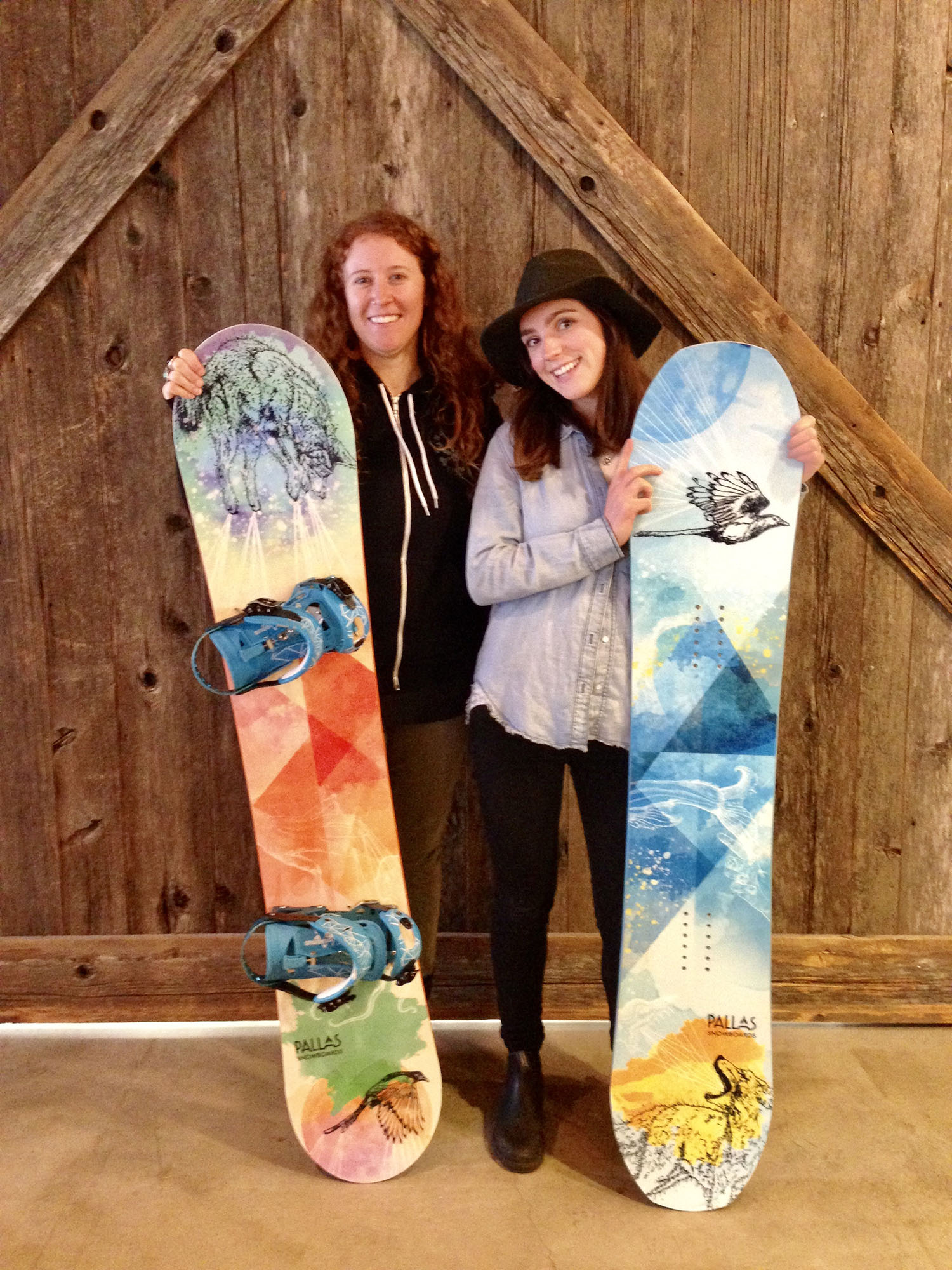 Pallas Snowboards – Steph and I holding the 2018 Girl Scout and Hedonist boards