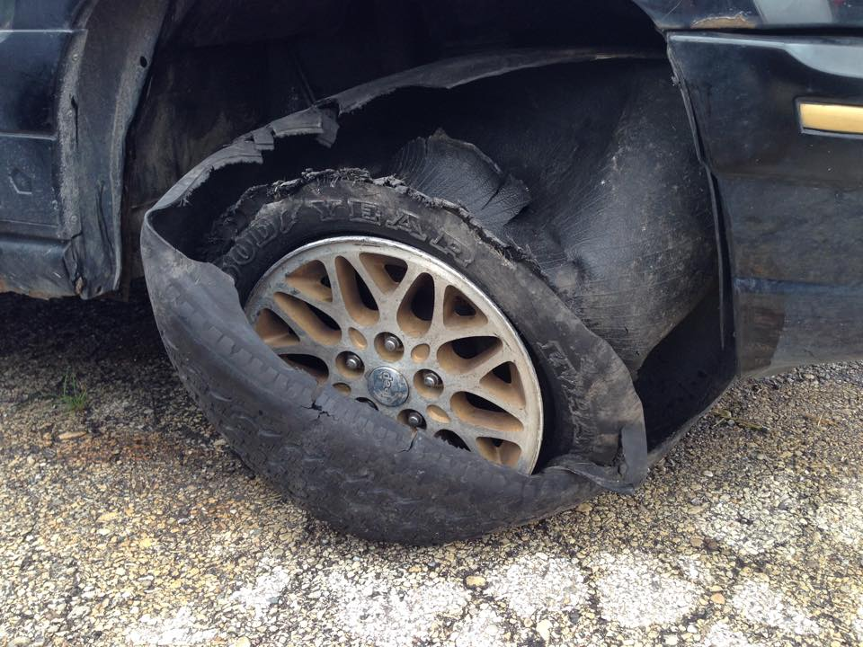 Photographs obtained by Syregelas Law of Defendant's vehicle after Defendant claimed blown tire was brand new and recently replaced.