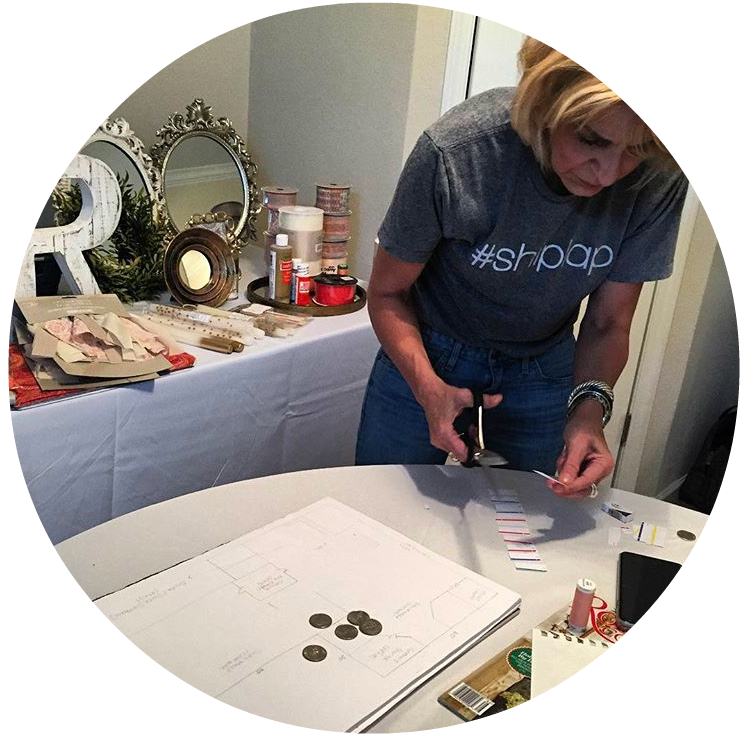 Carrie works on a room mock-up