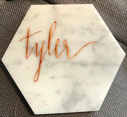 - Trademark is proud to offer in-house calligraphy services for place cards, seating charts, invitations, signage and just about anything you can imagine! Contact us for pricing and additional information.