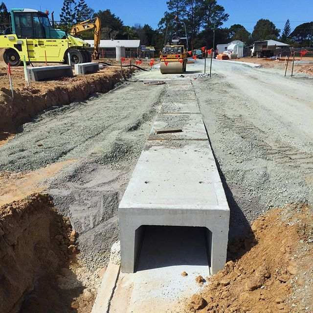 Installing culverts under the road.  #dnacivil #construction #roadworks #concrete #subdivision