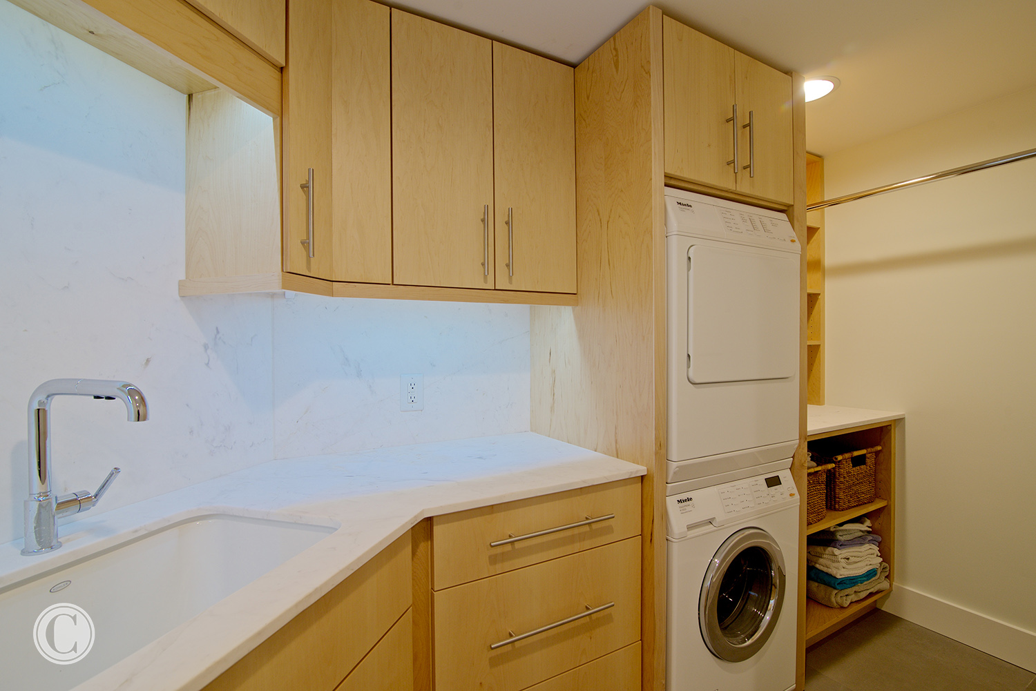 Jax Bch. Renovation, Acquilis Condominium, Laundry Room with Stacked Washer and Dryer | Cornelius Construction Company