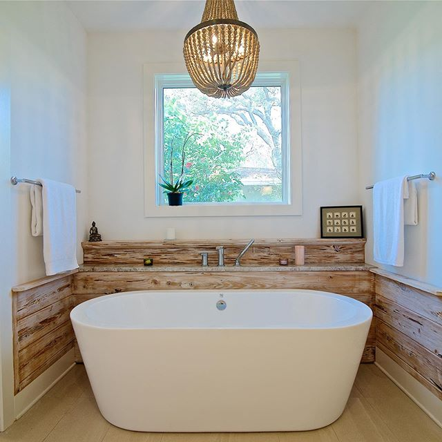 This remodeling project in Selva included a master bedroom and bathroom addition. The soaking tub surrounded by pecky cypress looks just divine, doesn't it? 🌞💖🌞 📷: @wallysearsphotography  #homerenovation #jacksonville #neptunebeach #homeremodel #builder #contractor #ilovemyclients