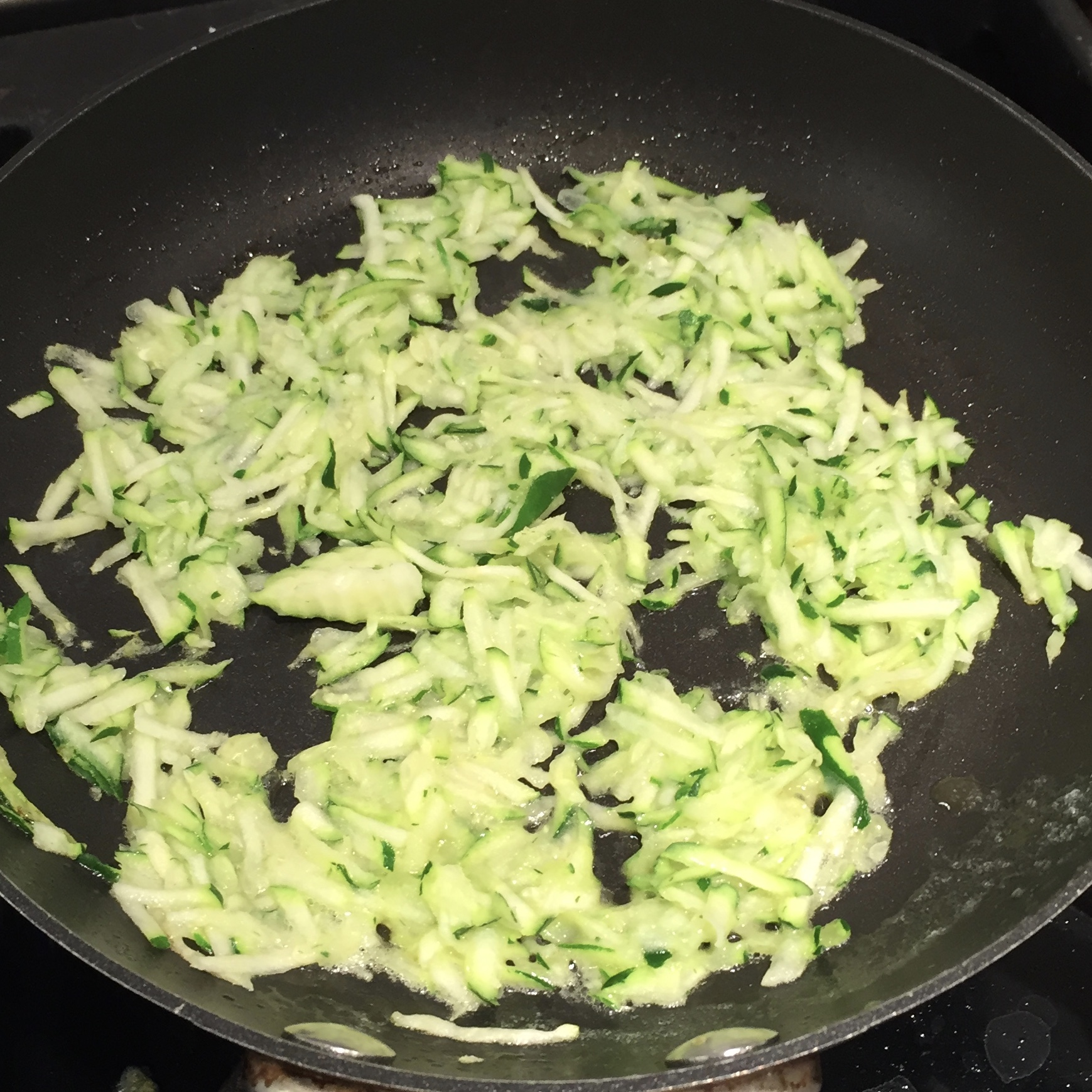 The entire process of washing, grating, and cooking the zucchini takes less time than it does to boil water for pasta!