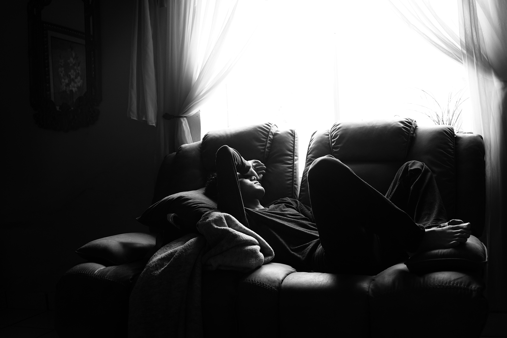 Brandon Resendez takes time to rest at his grandparent's home in a rancho called Cerro de Santiago in Durango, Mexico. Rancho life is for the most part quiet, often sleeping and napping in the day because it's so hot outside.