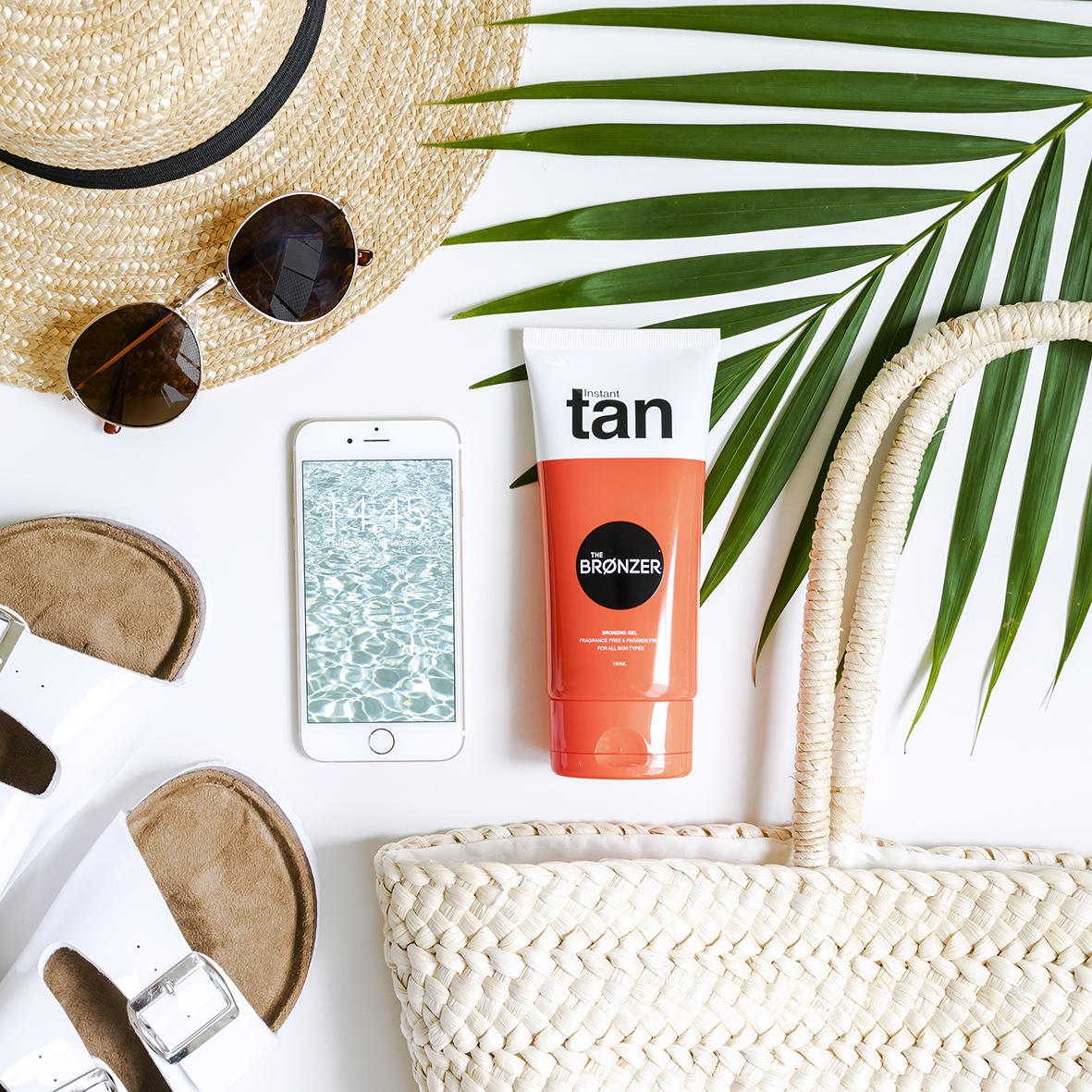 styled beach essentials flatlay photo