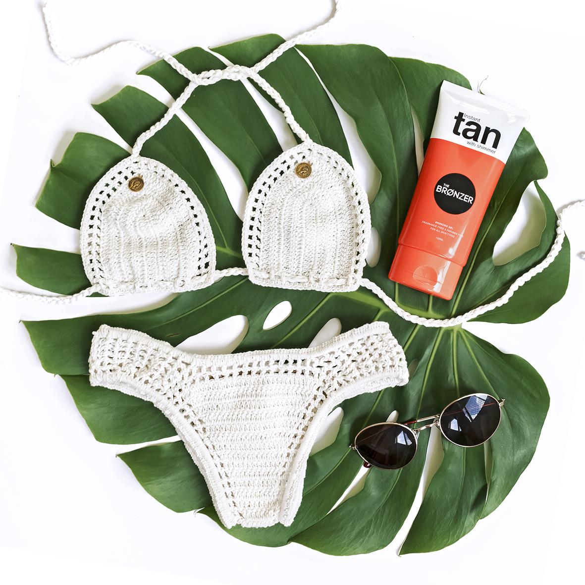 bronzer fake tan bikini flatlay