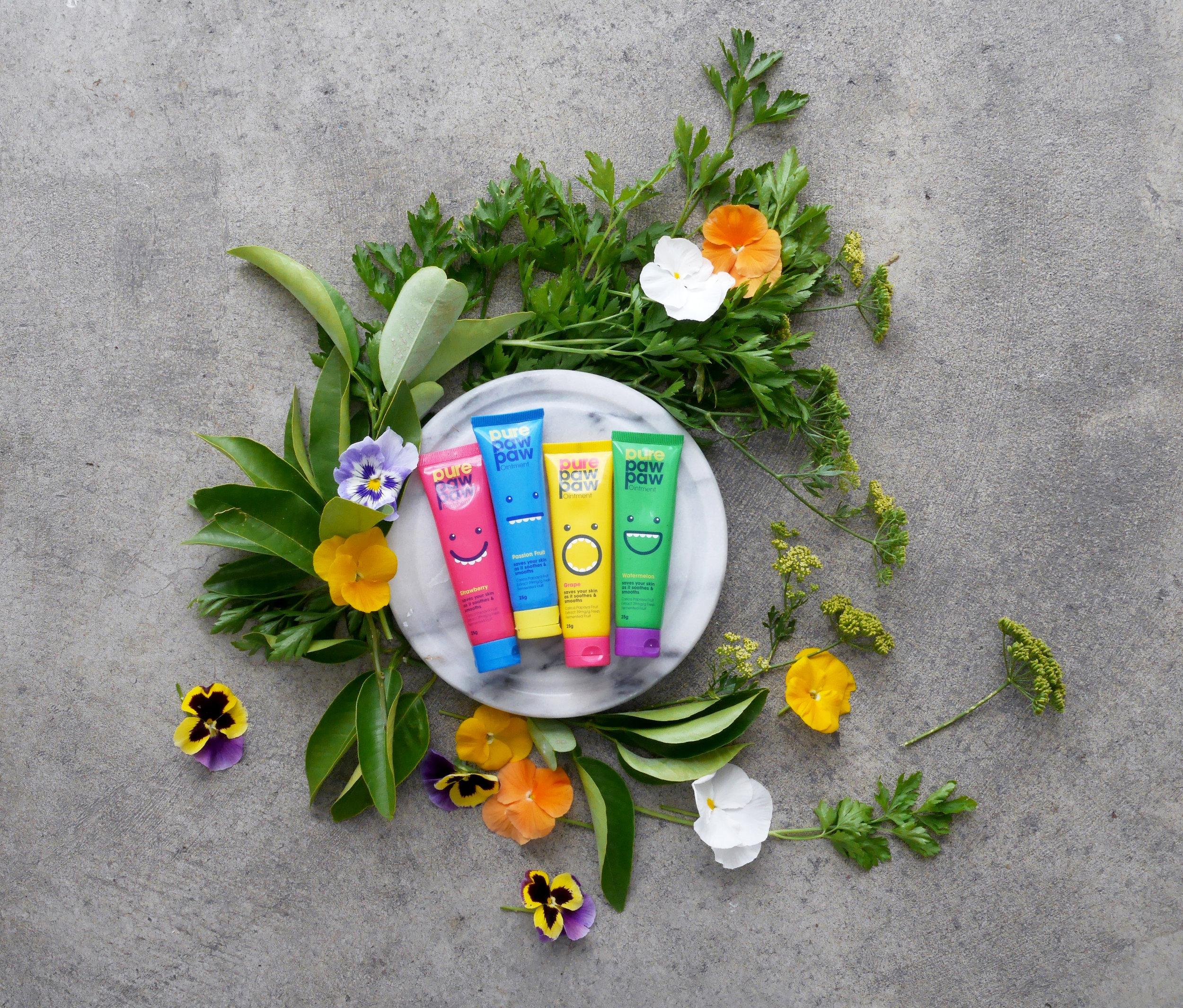 Colourful paw paw product botanical flatlay