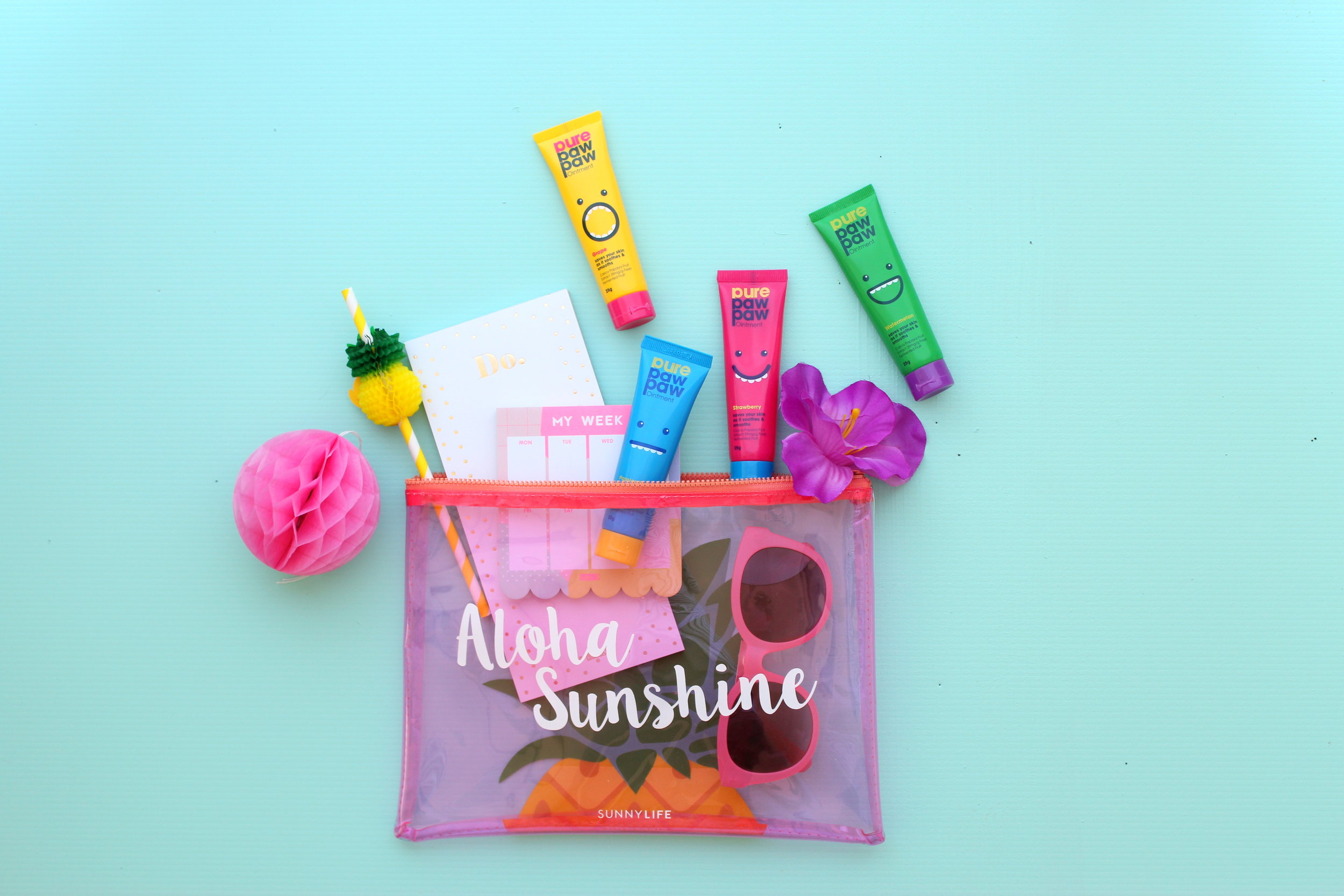 Colourful paw paw product fun tropical flatlay