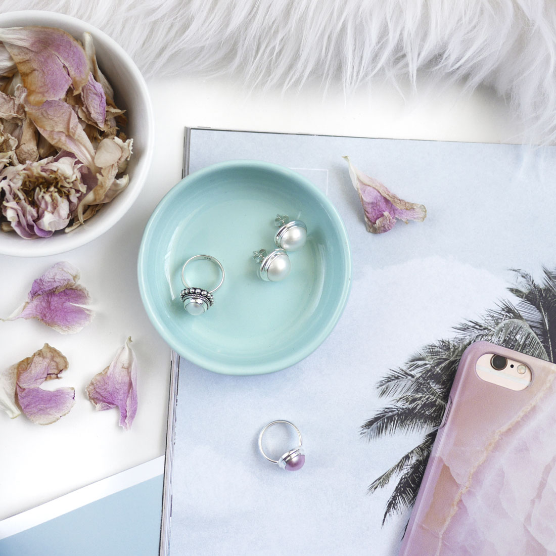 styled pink jewellery flatlay