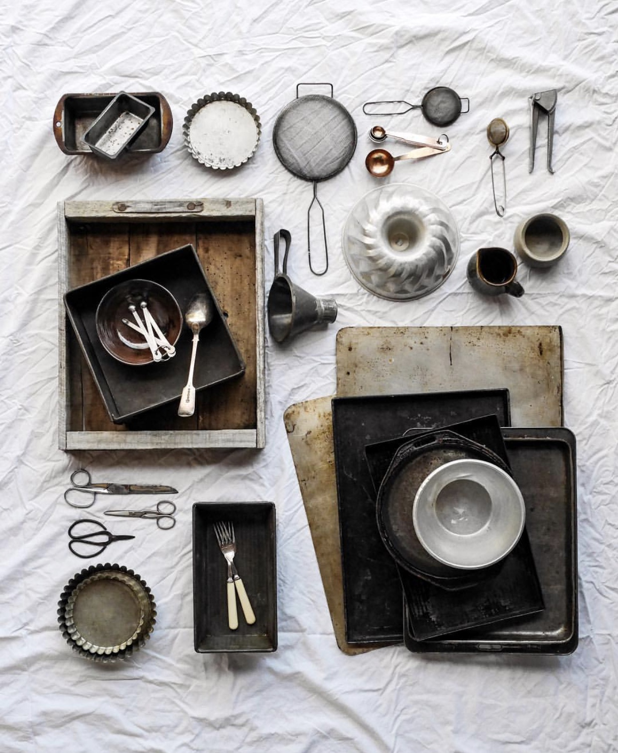 Patina on these time worn kitchen items can only be achieved through age. The crinkles on the bed sheet however, can be achieved simply by not ironing and folding it! By  @underthekowhai