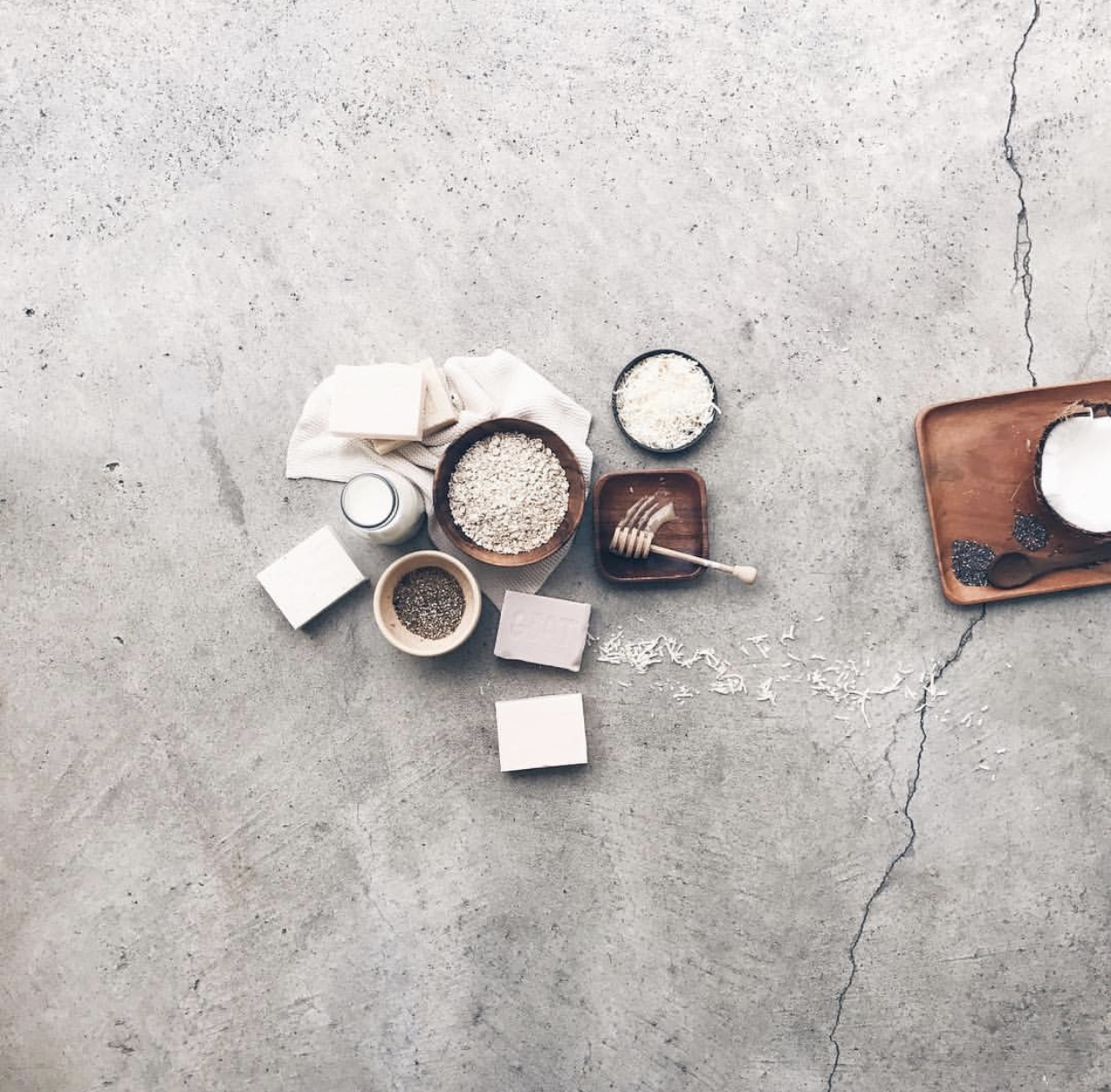 The concrete carport floor provides the perfect amount of texture, interest and aged imperfection for this collection of natural products. By  @underthekowhai
