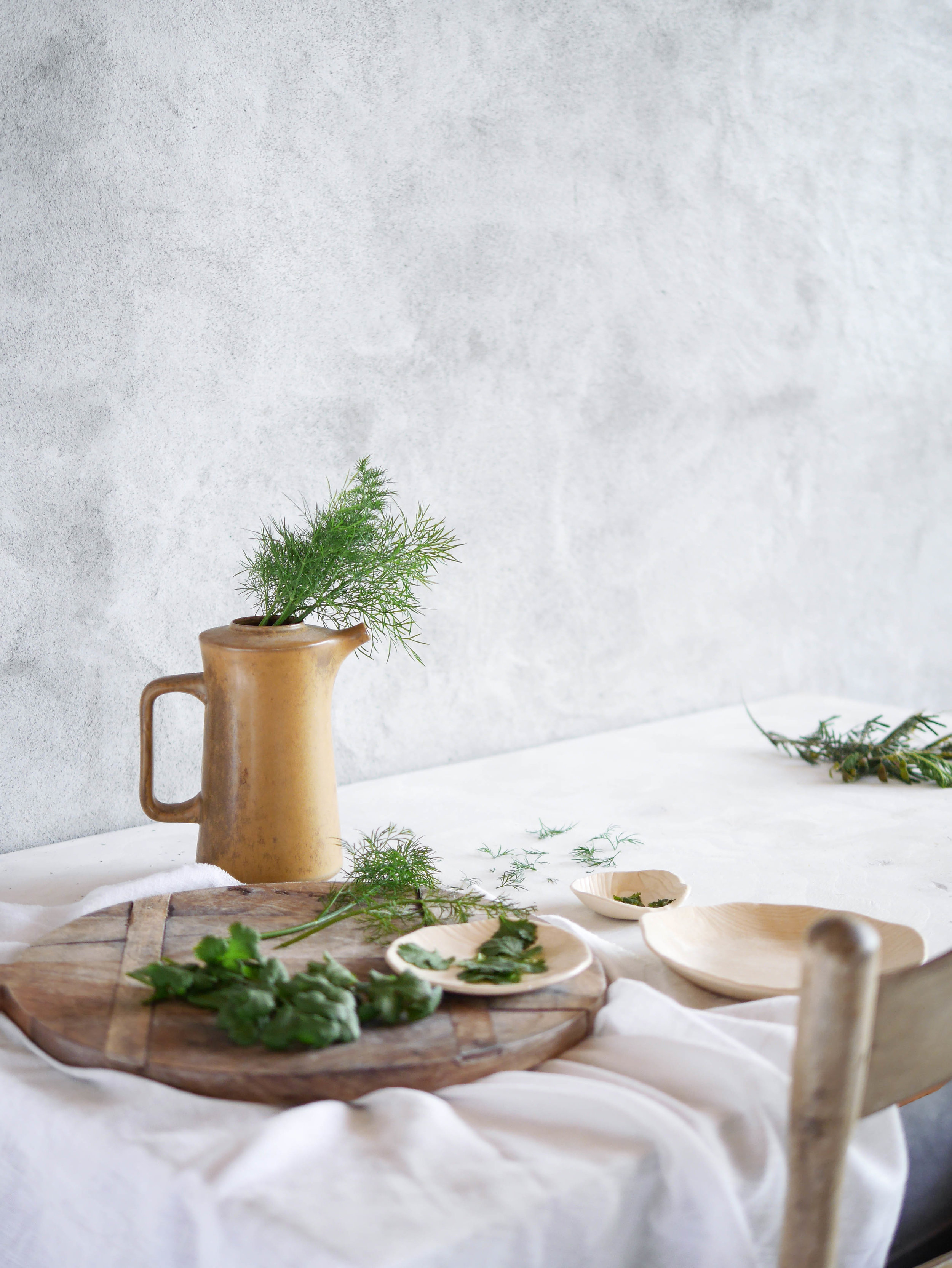 The simplicity of dishes and herbs is celebrated here, with simple flowing linens and a gently textured wall giving these elements the space they need. By  @underthekowhai