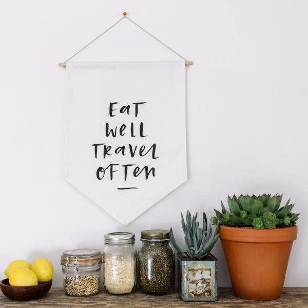 In the Daylight - 'Eat Well Travel Often' Wall Flag