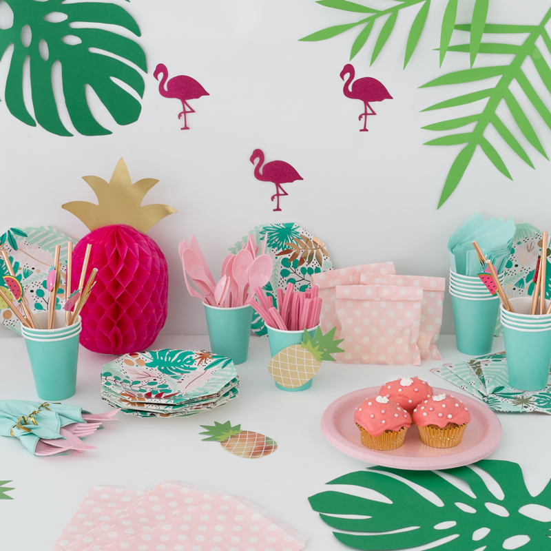 Using inexpensive paper cut outs to complement a Tropicana themed party kit.