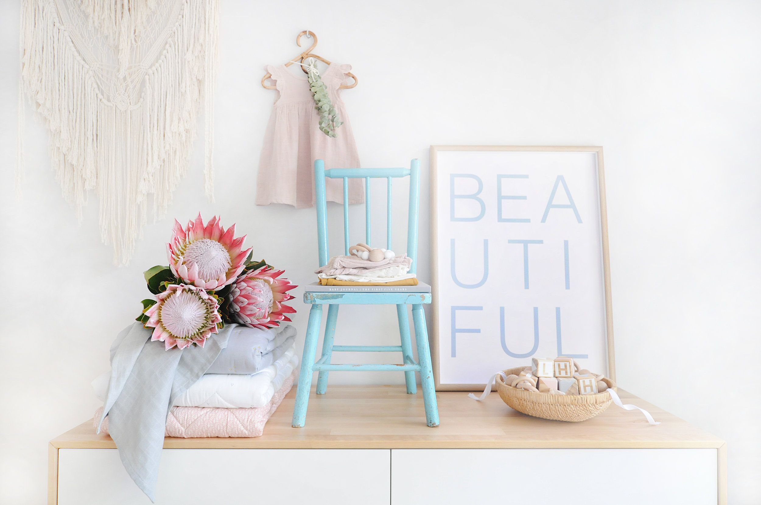 This image was created for an online baby boutique shop, and I love the mix of pastel tones and textures. i used some of my favourite props, Proteas, cane, macrame, and vintage chair